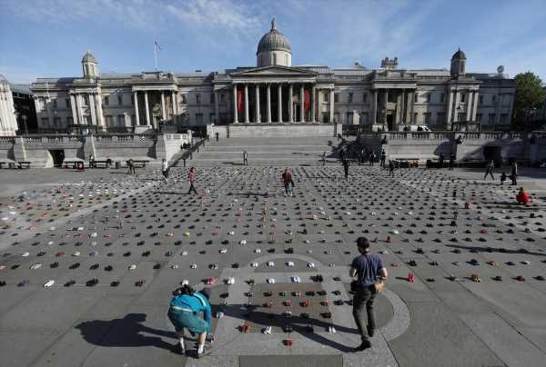 Climate activists line London's Trafalgar Square with kids' shoes