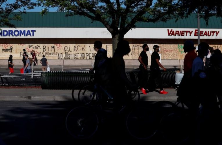 Retailers already hit by coronavirus board up as U.S. protests rage