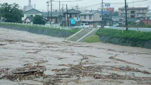 Heavy rains flood Japan, over a dozen presumed dead