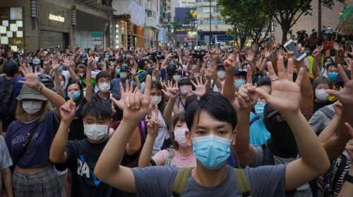Hong Kong: For those who stay, the fight is on as threats lurk