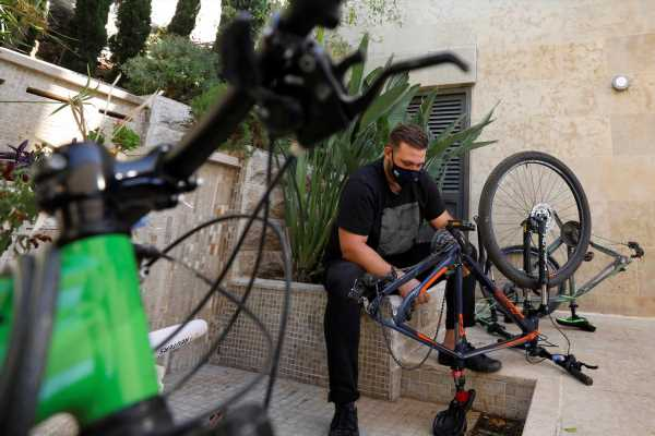 Palestinian cyclists say attacked by Israeli settlers after trail app led them astray