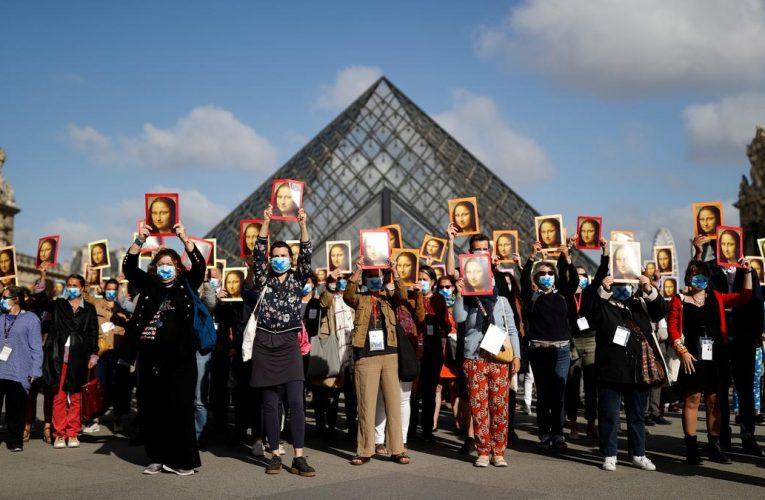 Don't forget us! Paris tour guides protest outside Louvre