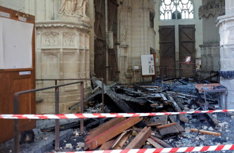 Lawyer says detained Nantes cathedral volunteer not linked to fire
