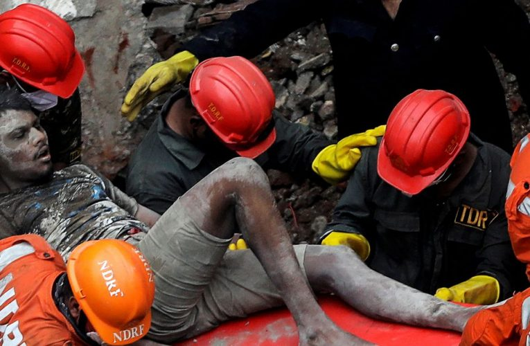 At least 10 dead and dozens feared trapped as three-storey building collapses