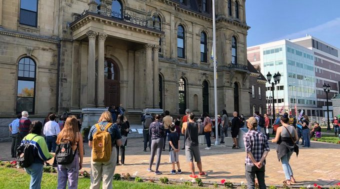 Security removes tents from protesters during vigil for Clinic 554 at N.B. legislature