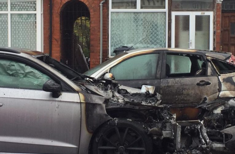 Armed police called to serious stabbing and burnt out cars on residential street