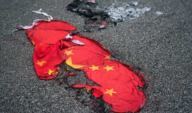 China criminalises insulting its national flag – including turning it upside down