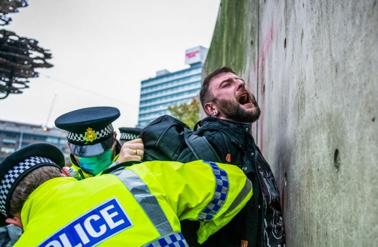 Lockdown protesters clash with police and chant 'rise up' in 'disgraceful' march