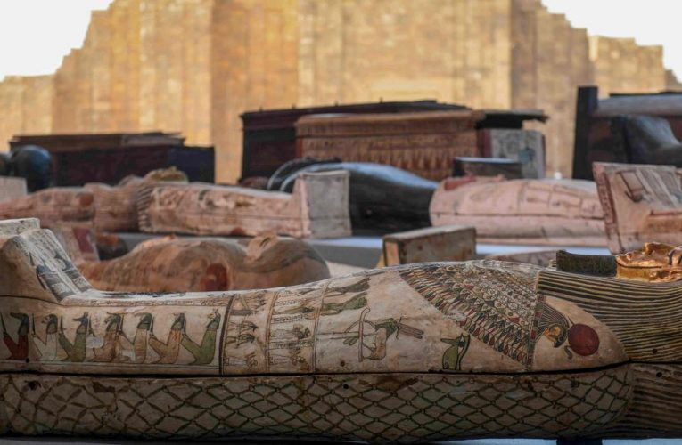 Egyptologists discover 100 coffins inside 2,500-year-old tomb in incredible find