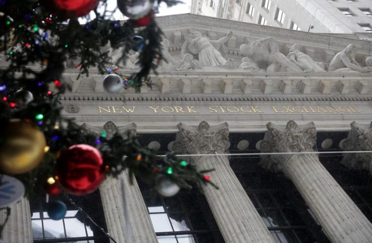 Wall St slips from record levels, path to $2,000 stimulus checks in focus
