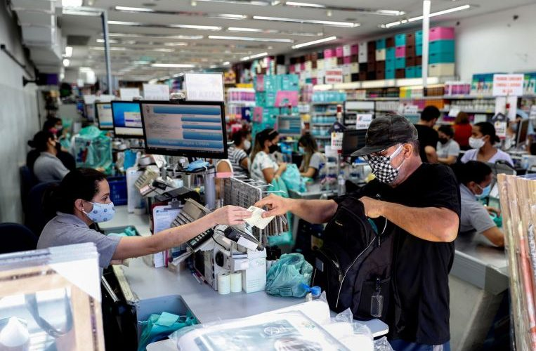 Raging coronavirus pandemic shuts down Sao Paulo as Brazil nears Pfizer deal