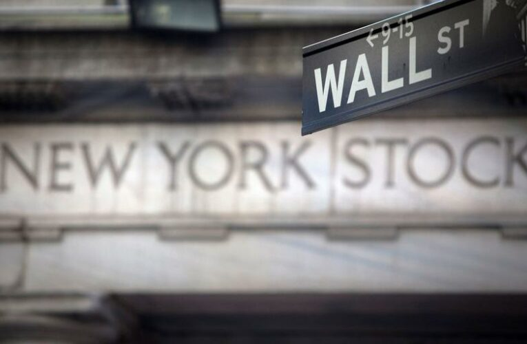 Wall St ends lower as investors await earnings, inflation data