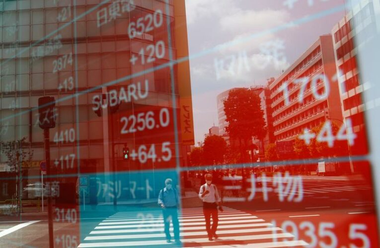 Shares lifted to record highs by lockdown easing, benign Fed