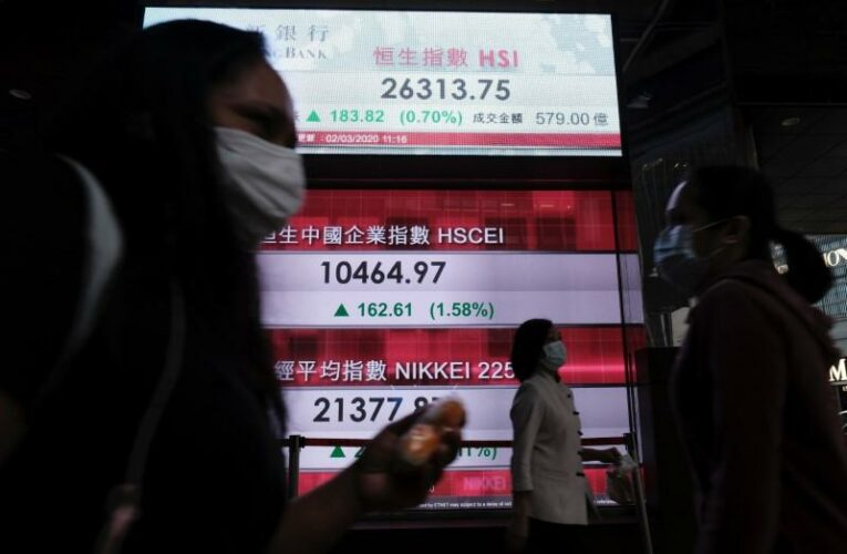 Asian shares slip, dollar up on higher rates outlook