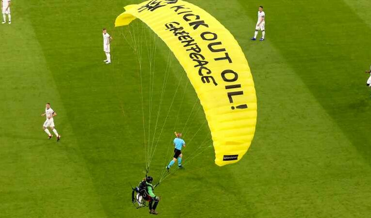 Climate protester parachutes on to pitch at Euro 2020 game