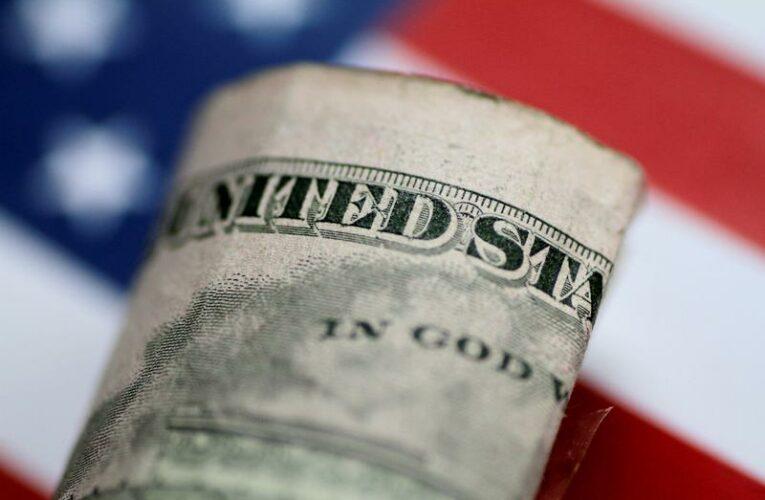 Dollar holds near multi-month high after Fed's hawkish tilt