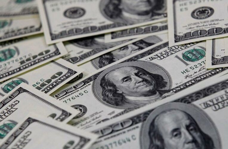 Dollar slips after Fed's Powell downplays inflation fears