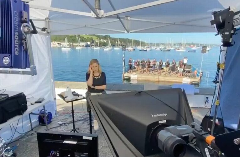 Reporter drowned out by barge of Cornish singers belting sea shanties on live TV