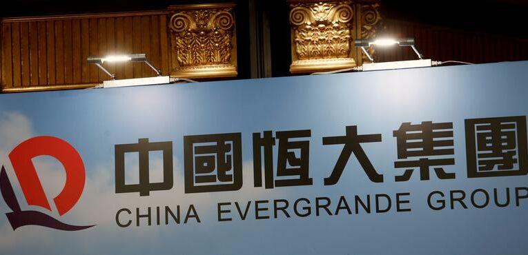 China Evergrande shares, bonds slump as investor worries persist