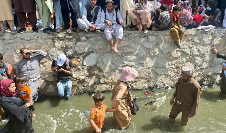 Afghanistan: Hope is all they have left – no good options left for refugees waiting in sewage-filled canal outside Kabul airport