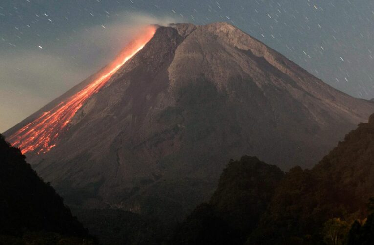 Huge volcano erupts with lava and gas as hot ash rains down on nearby towns